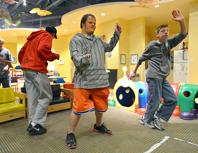 Troy Fielder, center, leads the dance with Cole Campbell, left, and Shawn Clark during Game Night at the Derda Recreation Center on Saturday. January 19, 2013 staff photo/ David R. Jennings