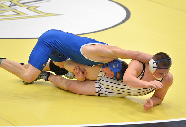 Longmont's Connor Stengel, left,  wrestles Golden's Brad Blackstock in the 170  lb. championship match during the Gary Daum Classic, Boulder Valley Invitational Wrestling Tournament at Frederick High School on Saturday.<br /> January 12, 2013<br /> staff photo/ David R. Jennings
