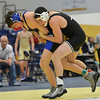 Longmont's Lane Olsen, left, wrestles Fairview's Chris Robinson in the 145 lb. championship match during the Gary Daum Classic, Boulder Valley Invitational Wrestling Tournament at Frederick High School on Saturday.<br /> January 12, 2013<br /> staff photo/ David R. Jennings
