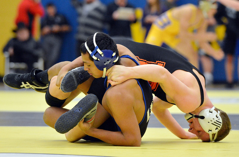 Longmont's Fernando Ramos Vega, left,  wrestles Erie's Ladd Bunker in the 160  lb. championship match during the Gary Daum Classic, Boulder Valley Invitational Wrestling Tournament at Frederick High School on Saturday.<br /> January 12, 2013<br /> staff photo/ David R. Jennings