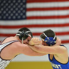 Longmont's Dutch Warner, right,  wrestles Golden's Noah Lennox in the 220  lb. championship match during the Gary Daum Classic, Boulder Valley Invitational Wrestling Tournament at Frederick High School on Saturday.<br /> January 12, 2013<br /> staff photo/ David R. Jennings