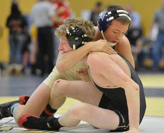 HolyFamily's  Joseph Prieto, right, wrestles Monarch's Landon Alm in the 126 lb. championship match during the Gary Daum Classic, Boulder Valley Invitational Wrestling Tournament at Frederick High School on Saturday.<br /> January 12, 2013<br /> staff photo/ David R. Jennings