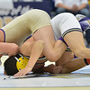 HolyFamily's  Vincent Casados, left, wrestles Jesse Ortiz, Frederick in the 113 lb. championship match during the Gary Daum Classic, Boulder Valley Invitational Wrestling Tournament at Frederick High School on Saturday.<br /> January 12, 2013<br /> staff photo/ David R. Jennings