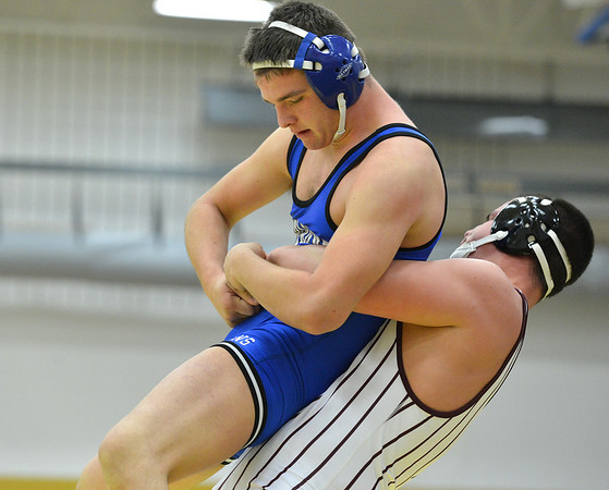 Longmont's Dutch Warner, left,  wrestles Golden's Noah Lennox in the 220  lb. championship match during the Gary Daum Classic, Boulder Valley Invitational Wrestling Tournament at Frederick High School on Saturday.<br /> January 12, 2013<br /> staff photo/ David R. Jennings