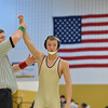 HolyFamily's  Joseph Prieto has his arm raised in victory after defeating Monarch's Landon Alm in the 126 lb. championship match during the Gary Daum Classic, Boulder Valley Invitational Wrestling Tournament at Frederick High School on Saturday.<br /> January 12, 2013<br /> staff photo/ David R. Jennings