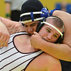 Longmont's Chris Palacios, top, wrestles Golden's Dakota Gulley in the 285  lb. championship match during the Gary Daum Classic, Boulder Valley Invitational Wrestling Tournament at Frederick High School on Saturday.<br /> January 12, 2013<br /> staff photo/ David R. Jennings