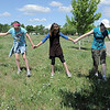 Sarah Carvo, 11, left, Gwen Lewis, 11, Paige Lewis, 11, Skye Lewis, 16, and Sarita Maharajh, 10, form a line to search for a GPS location  during the Mamie Doud Eisenhower Public Library's Geocache Planet Race for teens at Community Park on Tuesday.<br /> June 21, 2011<br /> staff photo/David R. Jennings