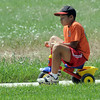C. J. Gomez, 12,rides a tricycle around a course for the Martian lander station  during the Mamie Doud Eisenhower Public Library's Geocache Planet Race for teens at Community Park on Tuesday.<br /> June 21, 2011<br /> staff photo/David R. Jennings