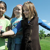 Paige Lewis, 11, holds a GPS instrument with help from Sarita Maharajh, 10, left, and Gwen Lewis, 11, as they try to figure out which direction to go to find the planet Saturn location during the Mamie Doud Eisenhower Public Library's Geocache Planet Race for teens at Community Park on Tuesday.<br /> June 21, 2011<br /> staff photo/David R. Jennings