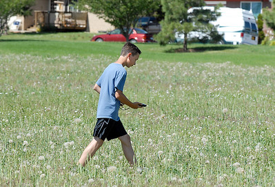 Antonio Cabrera, 12, searches for a GPS location in a field west of the library during the Mamie Doud Eisenhower Public Library's Geocache Planet Race for teens at Community Park on Tuesday. June 21, 2011 staff photo/David R. Jennings