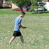 Antonio Cabrera, 12, searches for a GPS location in a field west of the library during the Mamie Doud Eisenhower Public Library's Geocache Planet Race for teens at Community Park on Tuesday.<br /> June 21, 2011<br /> staff photo/David R. Jennings