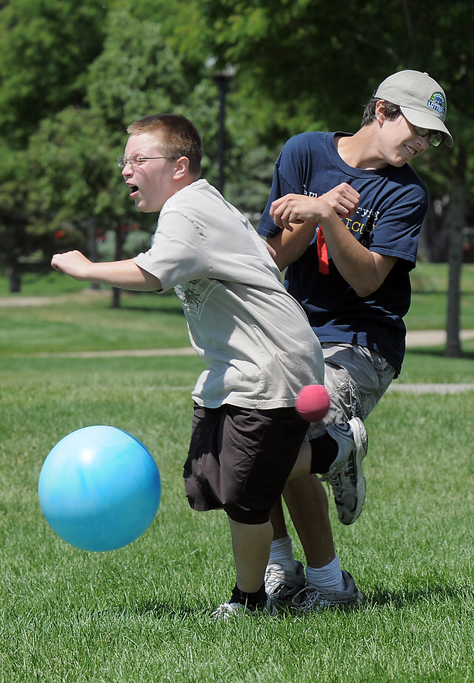 Val Sitchler, 12, collides with his brother Paris, 14, while running the asteroid gantlet during the Mamie Doud Eisenhower Public Library's Geocache Planet Race for teens at Community Park on Tuesday.<br /> June 21, 2011<br /> staff photo/David R. Jennings