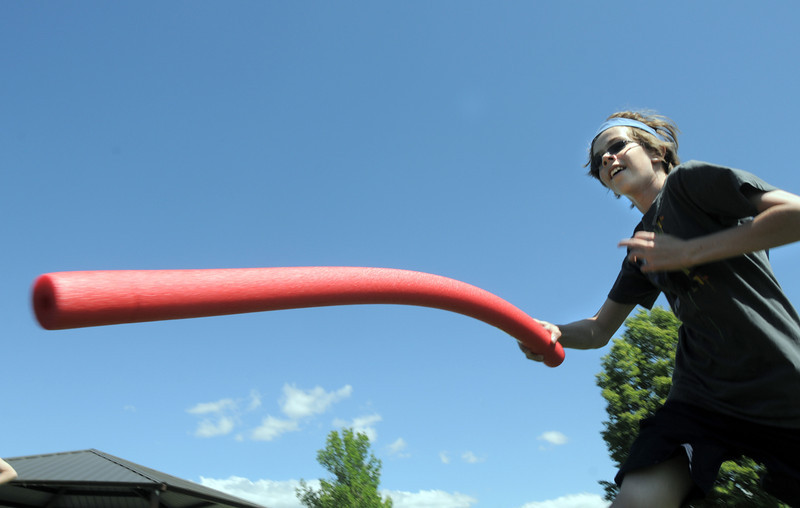 Nathan Hollister, 13, runs to tag a participant during the solar flair tag game at Mamie Doud Eisenhower Public Library's Geocache Planet Race for teens at Community Park on Tuesday.<br /> June 21, 2011<br /> staff photo/David R. Jennings