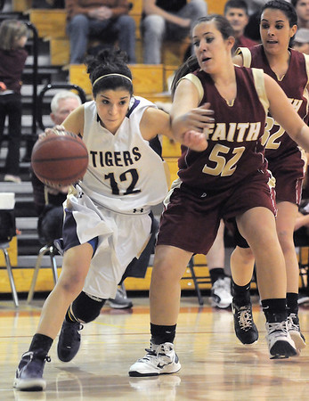 Holy Family's Megan Chavez drives the ball past Faith Christian's Amanda Odle during Thursday's Class 3A District 4 Basketball Tournament at Manual High School in Denver.<br /> February 23, 2012<br /> staff photo/ David R. Jennings