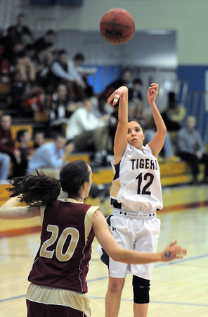 Holy Family's Megan Chavez shoots the ball over Faith Christian's Abigail Hegarty during Thursday's Class 3A District 4 Basketball Tournament at Manual High School in Denver.<br /> February 23, 2012<br /> staff photo/ David R. Jennings