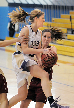 Holy Family's Stephanie Giltner tries to go for a layup against Faith Christian's Amanda Odle during Thursday's Class 3A District 4 Basketball Tournament at Manual High School in Denver.<br /> February 23, 2012<br /> staff photo/ David R. Jennings
