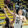 Holy Family's Kassie Johannsen reaches for the basket against Faith Christian's Cassandra Rindels during Thursday's Class 3A District 4 Basketball Tournament at Manual High School in Denver.<br /> February 23, 2012<br /> staff photo/ David R. Jennings