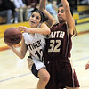 Holy Family's Megan Chavez goes to the basket against Faith Christian's Kayla Keiter during Thursday's Class 3A District 4 Basketball Tournament at Manual High School in Denver.<br /> February 23, 2012<br /> staff photo/ David R. Jennings