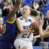 Broomfield's Nicole Lehrer goes to the basket against Wheat Ridge's DeAsia Griffin during Friday's state playoff game at Broomfield.<br /> February 24, 2012 <br /> staff photo/ David R. Jennings