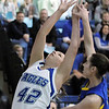 Broomfield's Stavie Hull reaches for the ball against Wheat Ridge's Sammi Huckaby during Friday's state playoff game at Broomfield.<br /> February 24, 2012 <br /> staff photo/ David R. Jennings