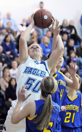 Broomfield's Callie Kaiser goes to the basket against Wheat Ridge's Katie Wirth during Friday's state playoff game at Broomfield.<br /> February 24, 2012 <br /> staff photo/ David R. Jennings