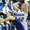 Broomfield's Stacie Hull shoots the ball over  Wheat Ridge's Erika Land during Friday's state playoff game at Broomfield.<br /> February 24, 2012 <br /> staff photo/ David R. Jennings