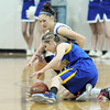 Broomfield's Brittney Zec fights for a loose ball against Wheat Ridge's Erkia Land during Friday's state playoff game at Broomfield.<br /> February 24, 2012 <br /> staff photo/ David R. Jennings