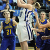 Broomfield's Calie Kaiser goes to the basket against Wheat Ridge during Friday's state playoff game at Broomfield.<br /> February 24, 2012 <br /> staff photo/ David R. Jennings