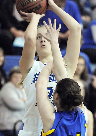 Broomfield's Meagan Prins shoots the ball over Wheat Ridge's Natalie Ross-Smith during Friday's state playoff game at Broomfield.<br /> February 24, 2012 <br /> staff photo/ David R. Jennings