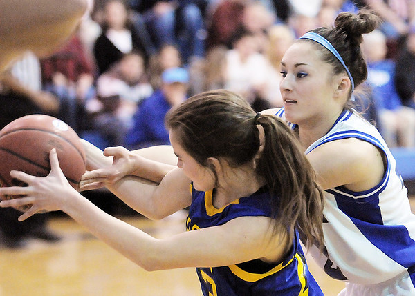 Broomfield's Brittney Zec foights for the ball  with Wheat Ridge's Serena Lewis during Friday's state playoff game at Broomfield.<br /> February 24, 2012 <br /> staff photo/ David R. Jennings