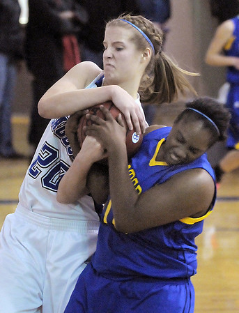 Broomfield's Meagan Prins fights for possession of the ball against Wheat Ridge's DeAsia Griffin during Friday's state playoff game at Broomfield.<br /> February 24, 2012 <br /> staff photo/ David R. Jennings