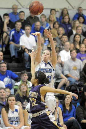 Broomfield's Brianna Wilber shoots the ball over  Holy Family's Megan Chavez during Saturday's cross-town rivalry game at Broomfield.<br /> January 28, 2012<br /> staff photo/ David R. Jennings