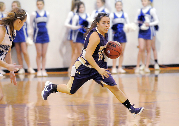 Holy Family's Lindsey Chavez drives the ball downcourt against Broomfield during Saturday's cross-town rivalry game at Broomfield.<br /> January 28, 2012<br /> staff photo/ David R. Jennings