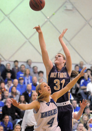 Holy Family's Kassie Johannsen goes to the basket over Broomfield's Morgan Rynearson during Saturday's cross-town rivalry game at Broomfield.<br /> January 28, 2012<br /> staff photo/ David R. Jennings