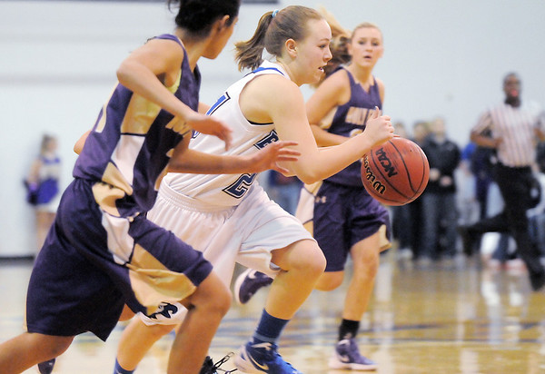 Broomfield's Nicole Lehrer drives the ball downcourt between Holy Family players during Saturday's cross-town rivalry game at Broomfield.<br /> January 28, 2012<br /> staff photo/ David R. Jennings