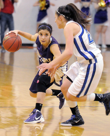 Holy Family's Megan Chavez dribbles the ball against Broomfield's Brittney Zec during Saturday's cross-town rivalry game at Broomfield.<br /> January 28, 2012<br /> staff photo/ David R. Jennings