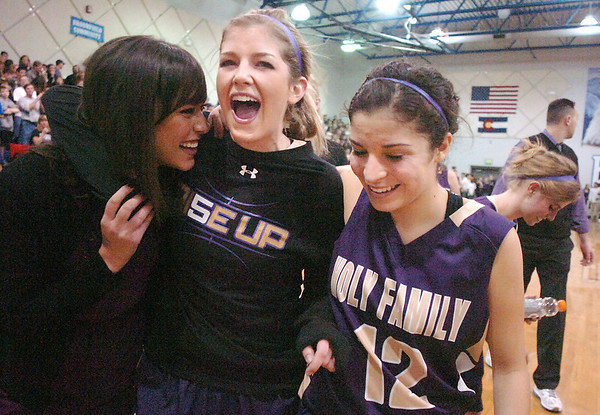 Holy Family's Stephanie Giltner, center, celebrates the Tigers win over the Eagles with Megan Chavez, right,  and assistant coach Suzie Chase during Saturday's cross-town rivalry game at Broomfield.<br /> January 28, 2012<br /> staff photo/ David R. Jennings
