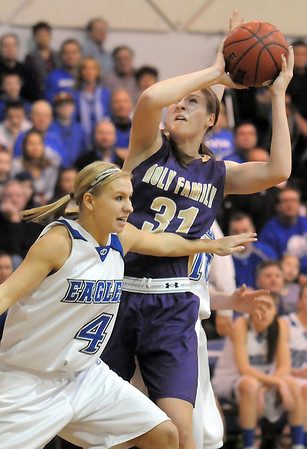 Holy Family's Kassie Johannsen goes to the basket against Broomfield's Morgan Rynearson during Saturday's cross-town rivalry game at Broomfield.<br /> January 28, 2012<br /> staff photo/ David R. Jennings