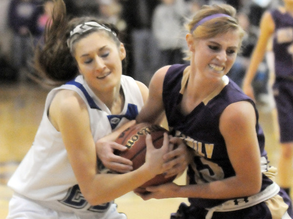 Holy Family's Mckenzie Zeman fights for possession of the ball with Broomfield's Brittney Zec during Saturday's cross-town rivalry game at Broomfield.<br /> January 28, 2012<br /> staff photo/ David R. Jennings