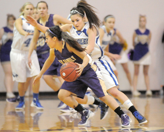 Holy Family's Megan Chavez dribbles the ball around Broomfield's Brittney Zec during Saturday's cross-town rivalry game at Broomfield.<br /> January 28, 2012<br /> staff photo/ David R. Jennings
