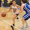 Holy Family's Katie Chavez dribbles the ball past Broomfield's Bri Wilbur during the cross town rivalry girls game at Holy Family on Friday.<br /> December 21, 2012<br /> staff photo/ David R. Jennings