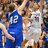 Holy Family's Lindsey Chavez goes to the basket against Broomfield's Stacie Hull during the cross town rivalry girls game at Holy Family on Friday.<br /> December 21, 2012<br /> staff photo/ David R. Jennings