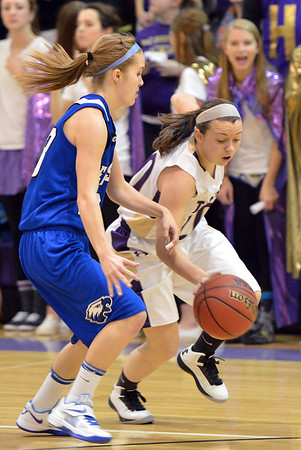Holy Family's Alex Jaros dribbles around Broomfield's Cherokee Rohrbough during the cross town rivalry girls game at Holy Family on Friday.<br /> December 21, 2012<br /> staff photo/ David R. Jennings