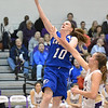 Broomfield's Bri Wilbur goes to the basket past Holy Family's Claudia Pena during the cross town rivalry girls game at Holy Family on Friday.<br /> December 21, 2012<br /> staff photo/ David R. Jennings
