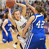 Holy Family's Claudia Pena tries to move the ball past Broomfield's Stacie Hull during the cross town rivalry girls game at Holy Family on Friday.<br /> December 21, 2012<br /> staff photo/ David R. Jennings