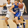 Broomfield's Nicole Lehrer dribbles the ball downcourt against Holy Family's Katie Chavez during the cross town rivalry girls game at Holy Family on Friday.<br /> December 21, 2012<br /> staff photo/ David R. Jennings