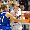 Holy Family's Megan McGillin fights for control of the ball with  Broomfield's Katie Croell during the cross town rivalry girls game at Holy Family on Friday.<br /> December 21, 2012<br /> staff photo/ David R. Jennings