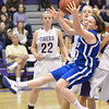 Broomfield's Bri Wilbur reaches for the ball against Holy Family's Micaela Blanchard during the cross town rivalry girls game at Holy Family on Friday.<br /> December 21, 2012<br /> staff photo/ David R. Jennings