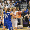 Holy Family's Alex Jaros fights for control of the ball with  Broomfield's Katie Croell during the cross town rivalry girls game at Holy Family on Friday.<br /> December 21, 2012<br /> staff photo/ David R. Jennings