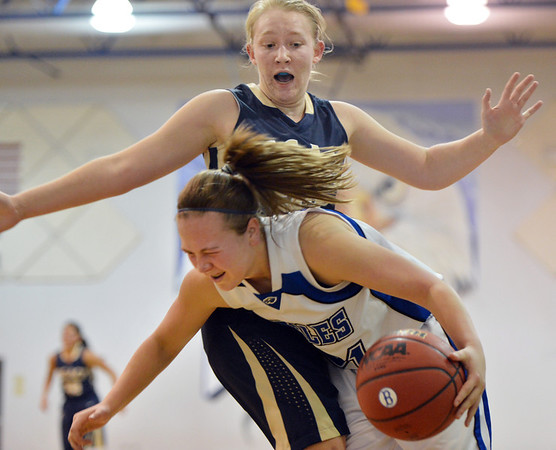 Broomfield's  Nicole Lehrer tries to dribble around Legacy's Courtney Smith during Saturday's girls basketball game at Broomfield.<br /> <br /> December 1, 2012<br /> staff photo/ David R. Jennings